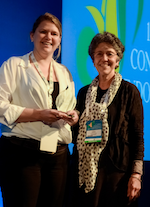 WES President, Linda Giudice, presents Aisha De Graaff with her award at the WCE2014 Closing Ceremony